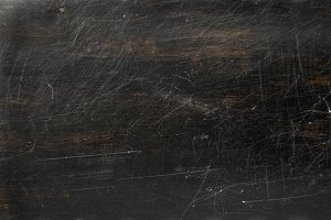 Dark brown scratched wooden texture, background with copy space. Banner