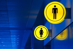Male, female toilet, restroom sign. Man and woman equality concept. Copy space.