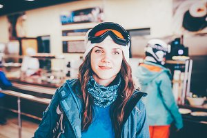 Happy girl on ski resort.