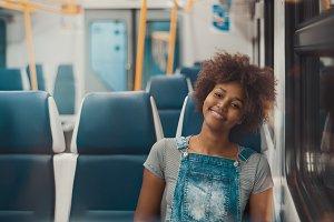 Cheerful black girl, suburban train