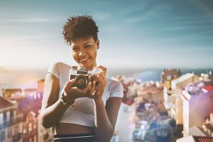 Black girl with retro photo camera