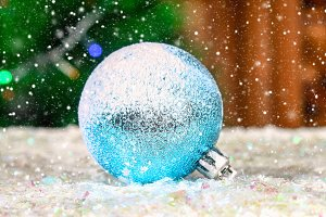 One blue New Year's ball in the snow. Christmas atmosphere.