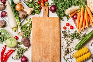 Empty cutting board and vegetables