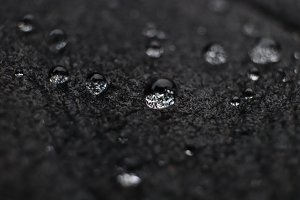 Water drops on black leather