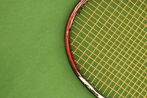 Tennis Racket on Green Playground
