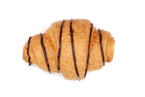 croissant decorated with chocolate sauce isolated on white background, top view