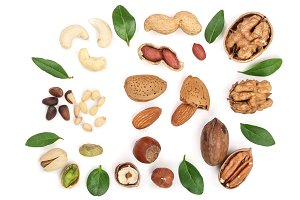 mix of different nuts with leaves isolated on white background, Flat lay pattern, Top view