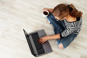 Woman working at laptop at home