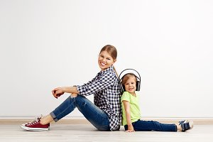 Little girl in headphones with mum