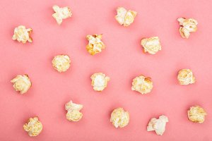 Popcorn on red background. Top view. Flat lay pattern