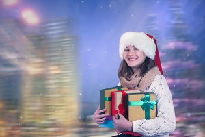 Beautiful girl with gifts in hands