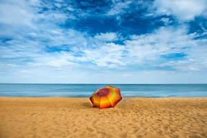 Orange umbrella on beach