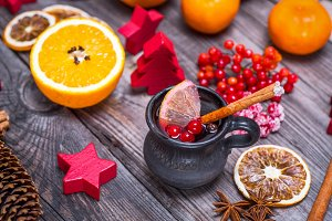 Mulled wine in a brown ceramic cup