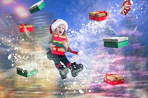Happy girl flying in a snowstorm among the many gifts. The concept of the Christmas discounts and sales