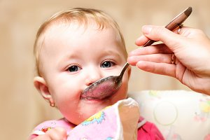 Girl eating from spoon