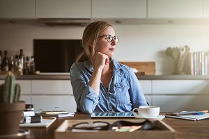 Young woman deep in thought while working from home
