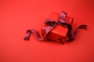 Arranged red giftbox on red