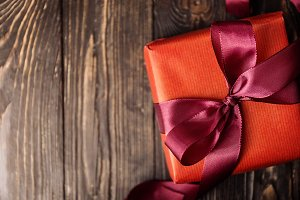 Wrapped bright gift on wood