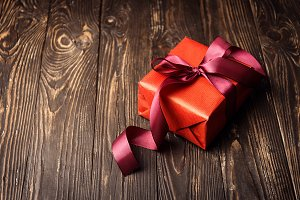 Box wrapped in red ribbon