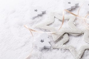 White shiny stars on snow