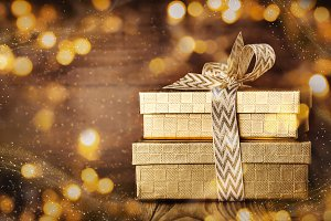 Shining giftboxes in golden glitters