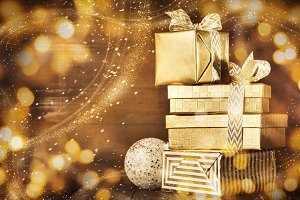 Shiny gold boxes with Christmas presents