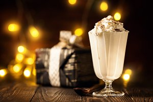 Delicious milkshake in arrangement with Christmas decor