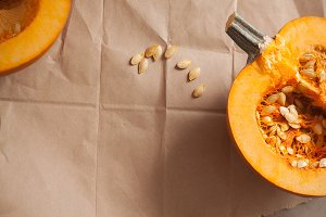 Pumpkin halves on brown paper