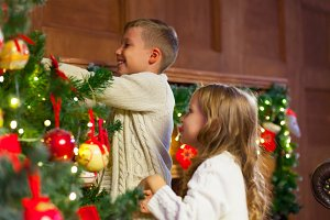 Portrait of happy children decorating Christmas tree.Family, chr