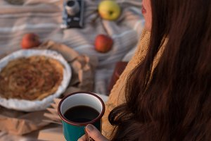 Cozy autumn concept. Woman at picnic