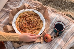 Outdoor picnic with apple pie and te