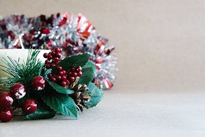 Christmas holiday ornaments on rustic background