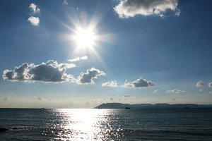 Fantastic indigo sea ocean sunset clouds sky landscape photo