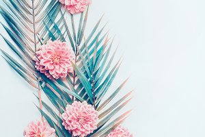 Tropical leaves and pink flowers