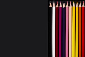 Multicolour pencils on black background. Art and creativity concept.