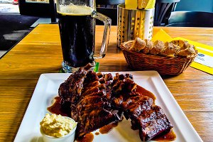 Mug of beer and plate of grilled pork ribs in Prague, Czech Repu