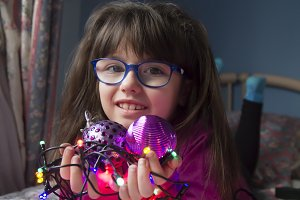 girl with christmas lights