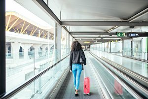 woman in the moving walkway