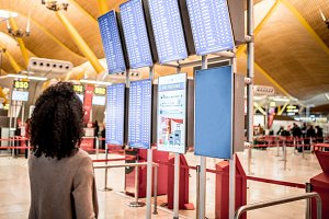 woman looking the timetable airport