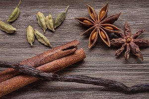 Set of spices on dark background.