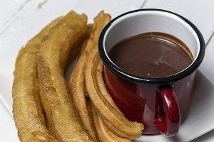 Churros with chocolate sauce.