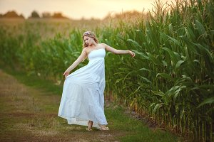 Woman is dancing in the field.