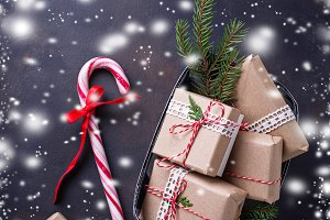 Christmas gift boxes and candy cane.