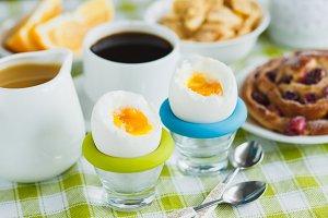 Soft boiled chicken egg, coffee, baking, muesli and orange juice
