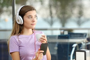 Serious teenager listening to music