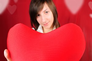 Teenage girl with red heart