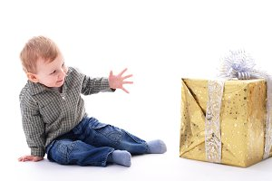 Boy with gift isolated