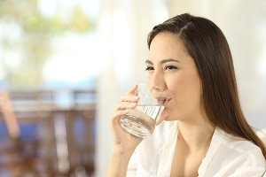 Happy woman drinking water