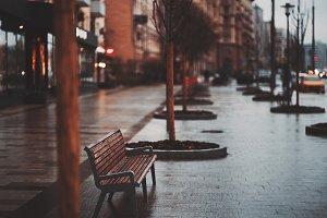 Bench on rainy street
