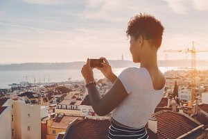 Girl taking panoramic picture